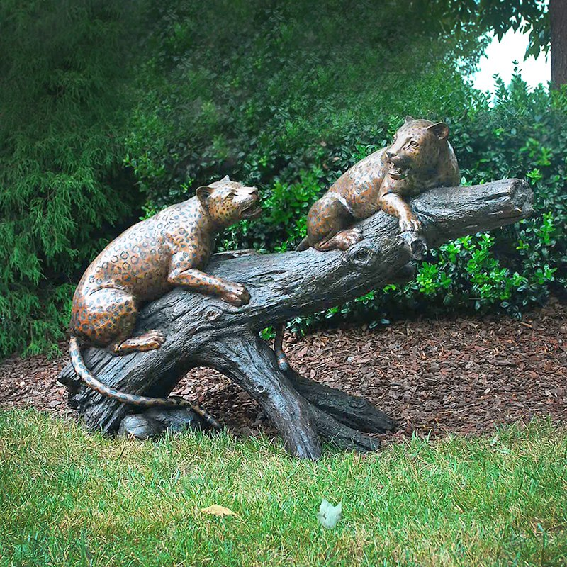 sculpture leopards on branch