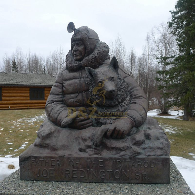 man and wolf sculpture