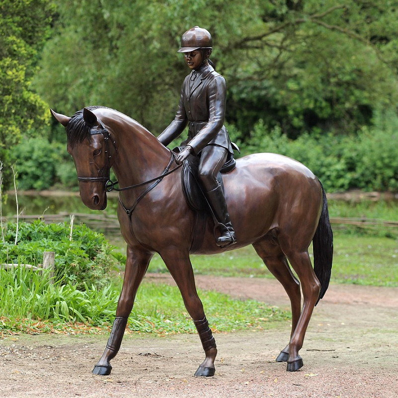 girl riding horse sculpture