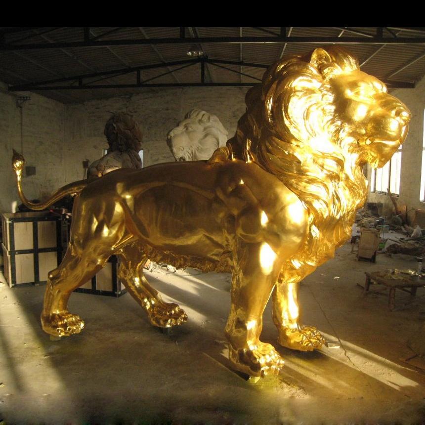 Golden stone lion sculpture