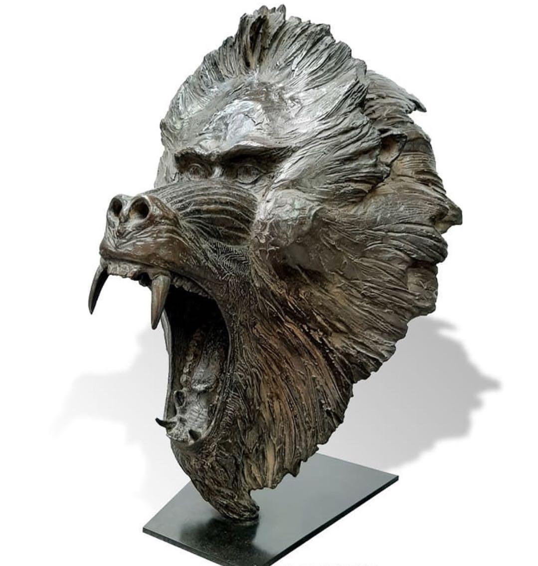 Black orangutan head sculpture