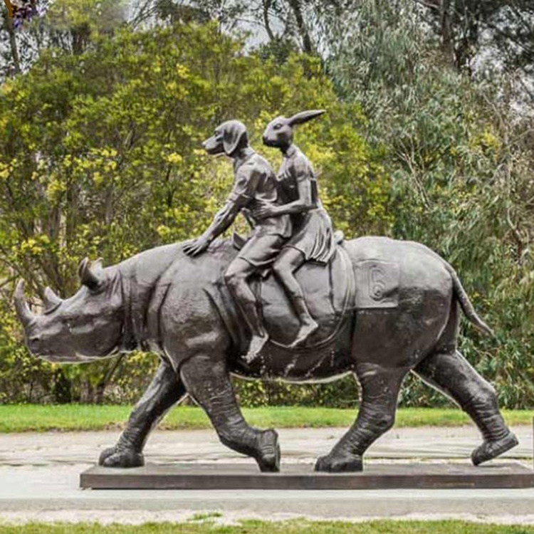 dog and rabbits ride rhinos