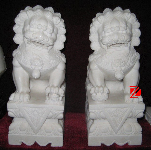 small marble lion statues