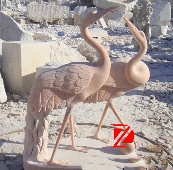 crane garden statue