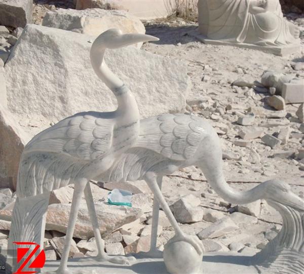 white crane sculpture