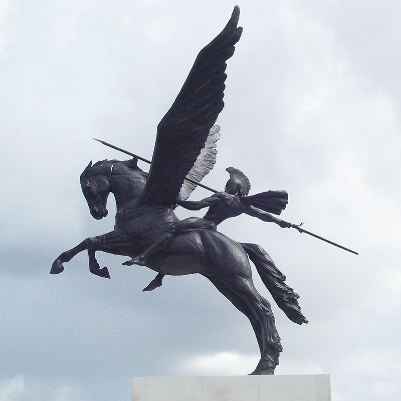 bronze winged horse sculpture and rider