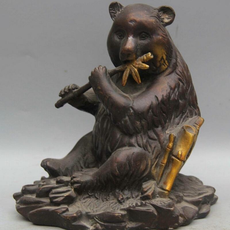 bronze panda sculpture eating bamboo