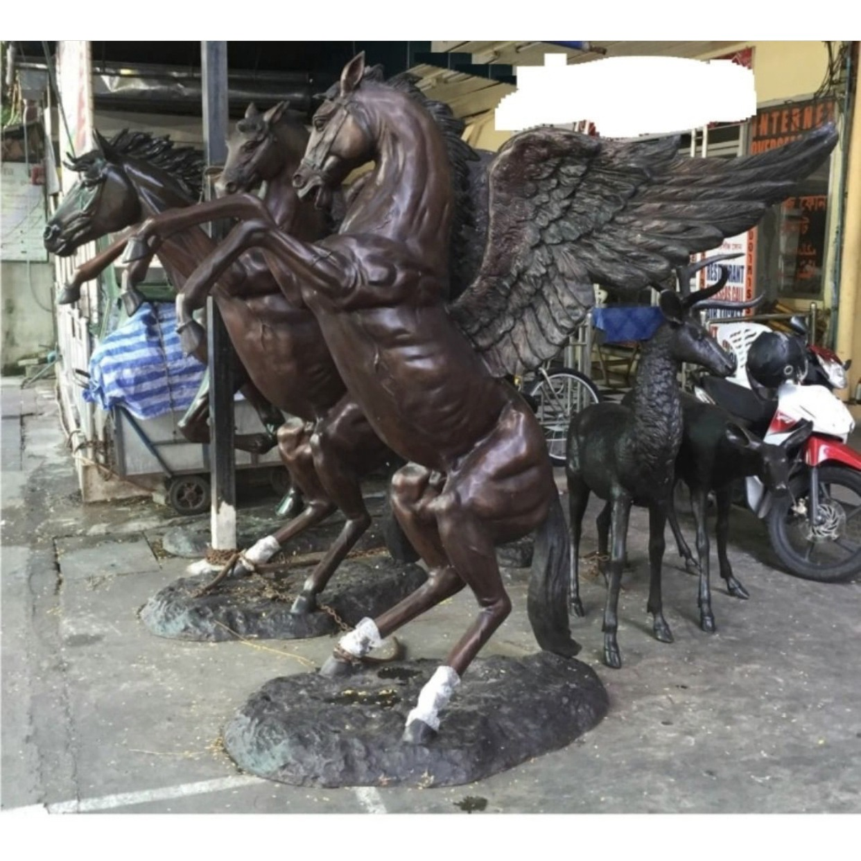 copper winged horse statue lifting legs