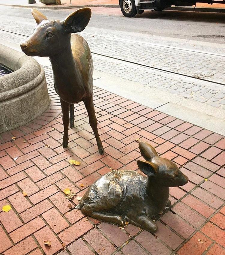 deer and deer mother statue