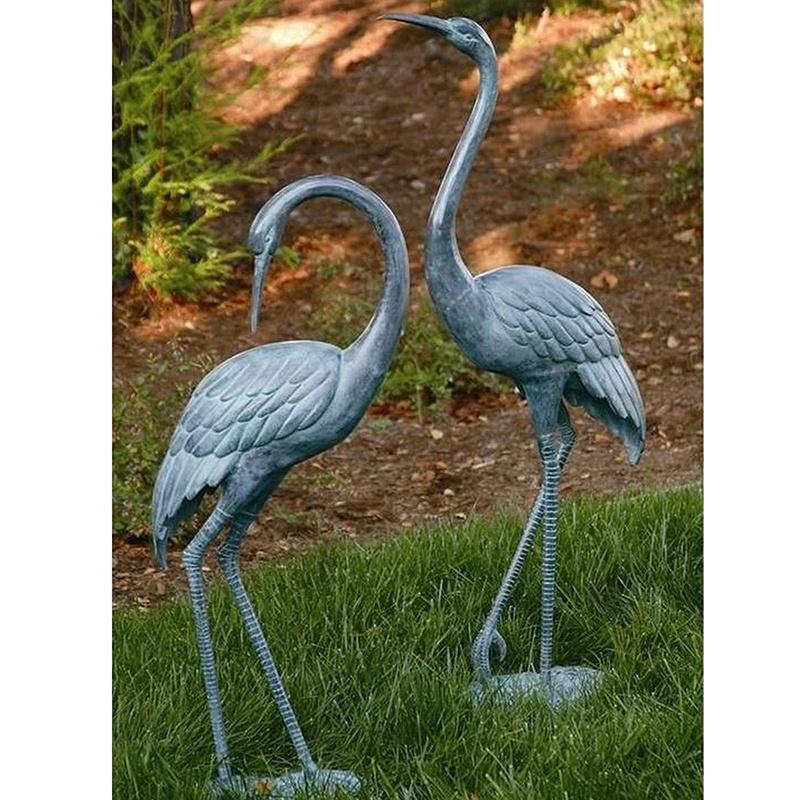 metal crane in garden sculpture
