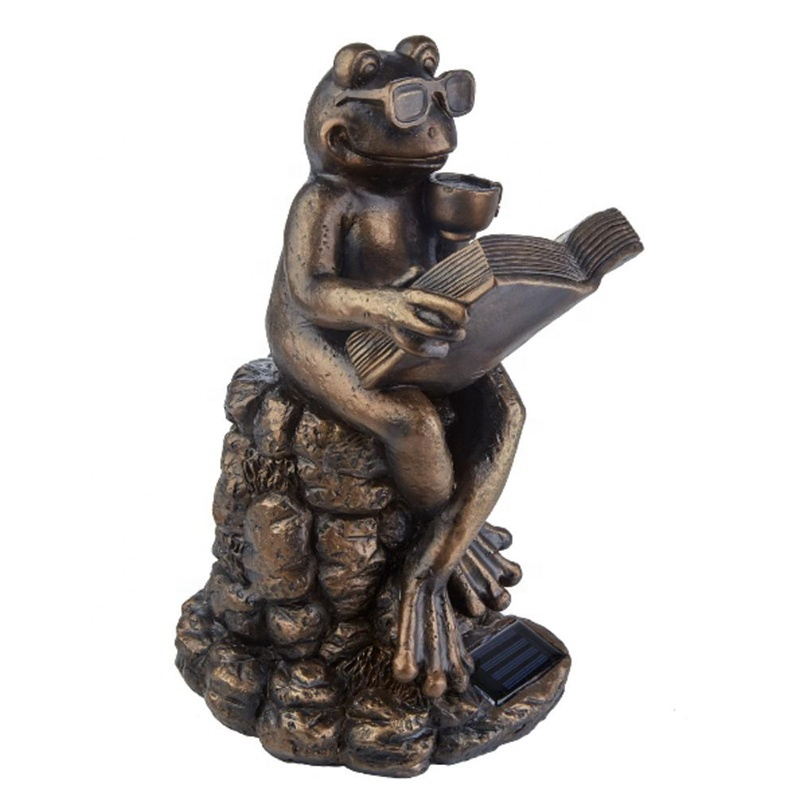 frog reading sculpture