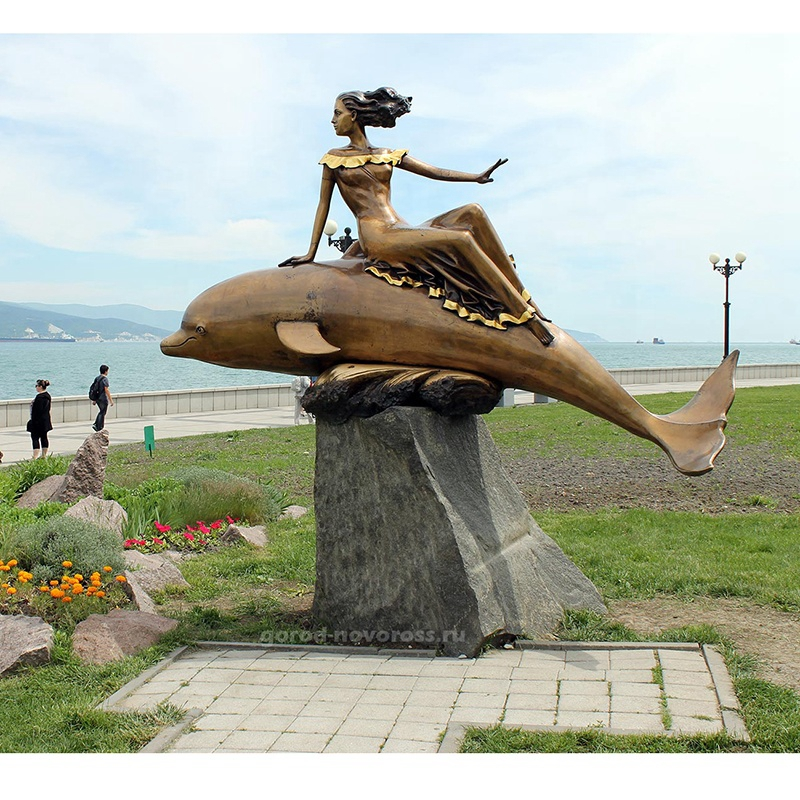 bronze statues of dolphins and mermaids
