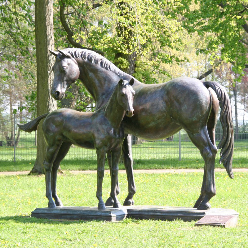 two horse sculptures