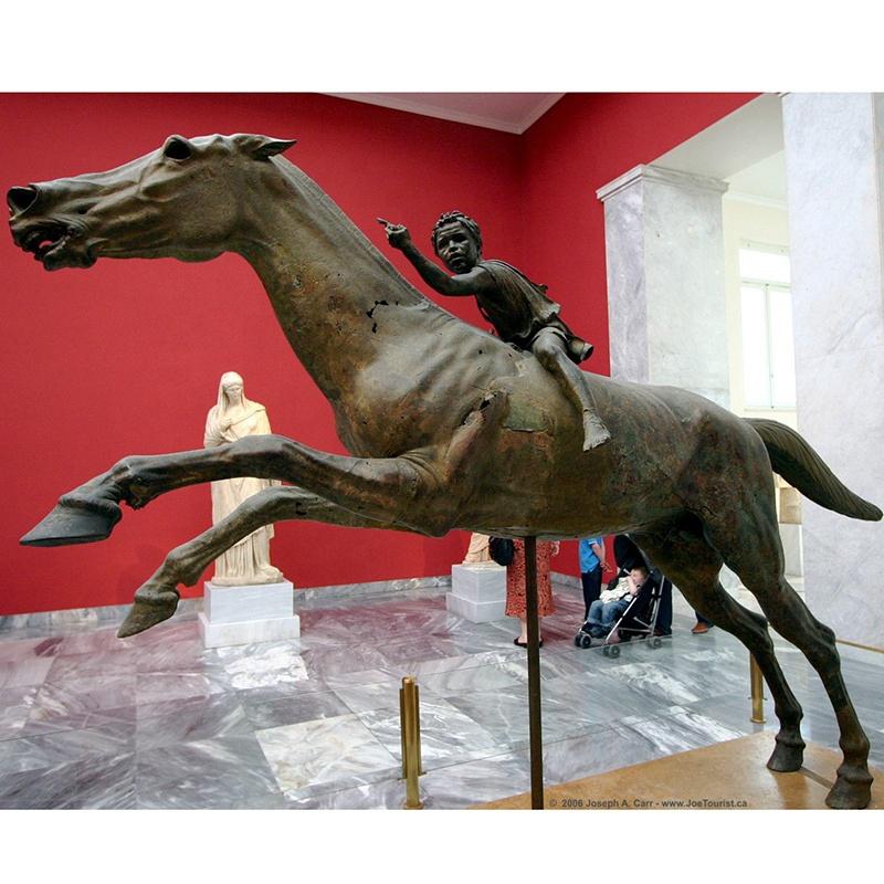 child on horse sculpture
