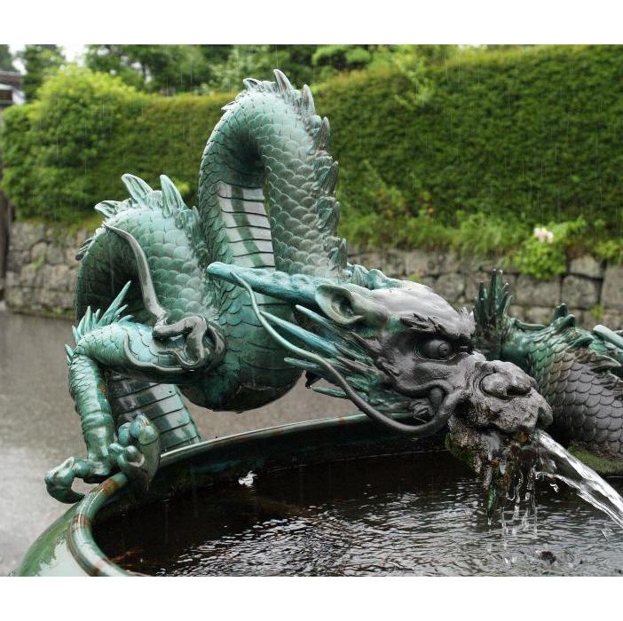 dragon spraying fountain sculpture