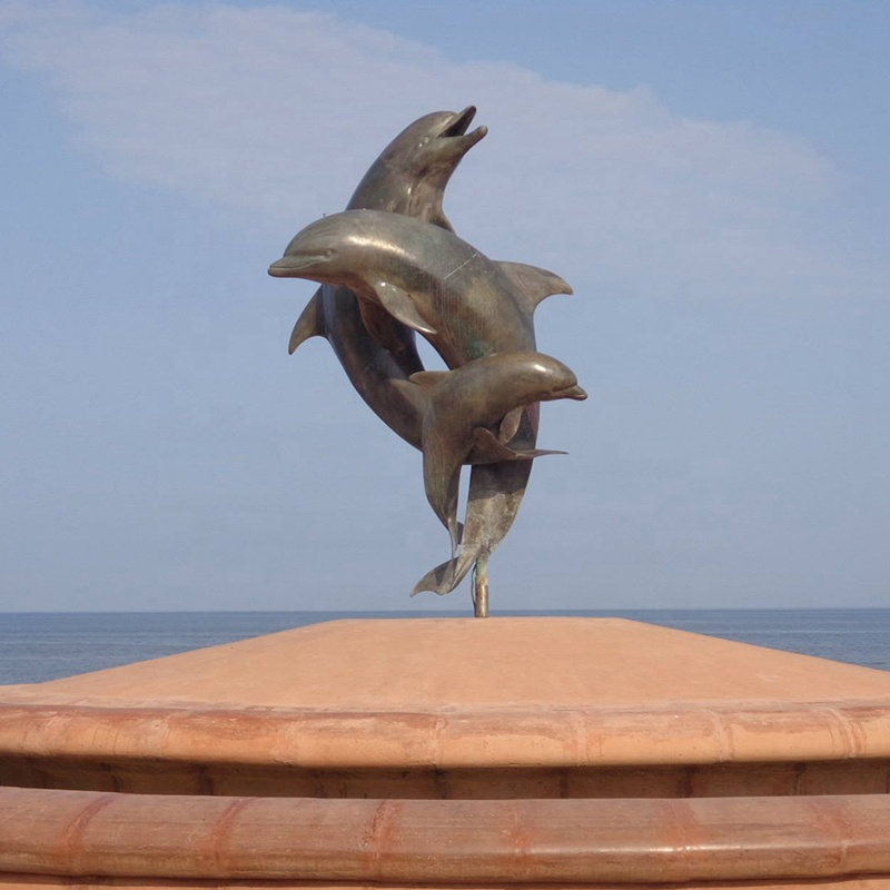 metal dolphins jumping sculpture