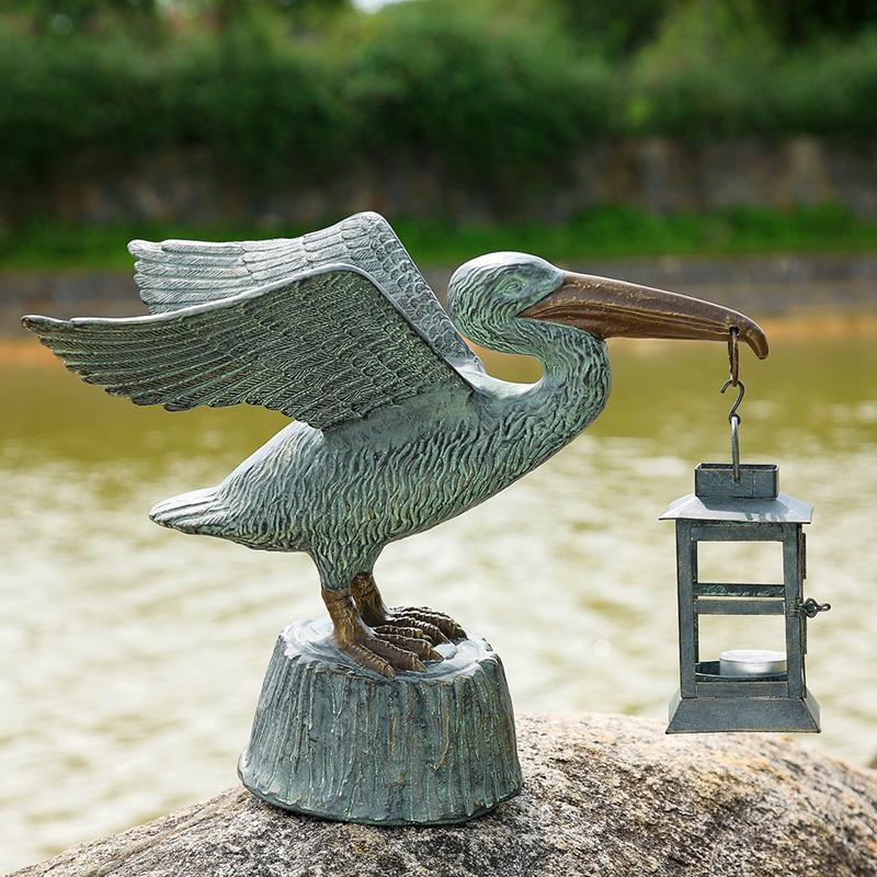 bird with lamp sculpture