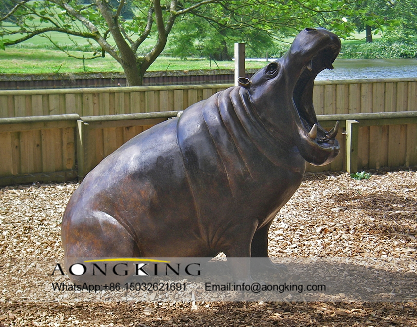 Black hippopotamus sculpture