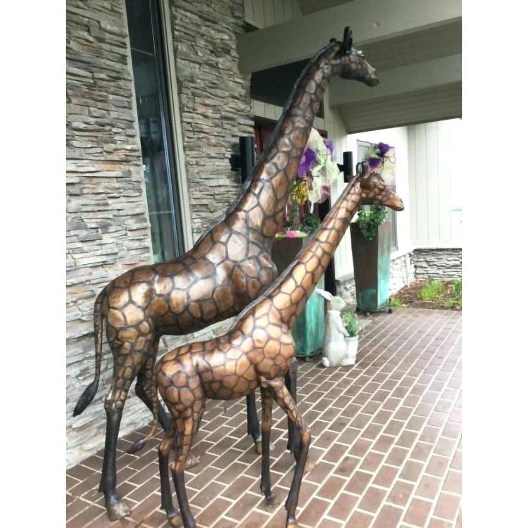 Large bronze giraffe sculpture
