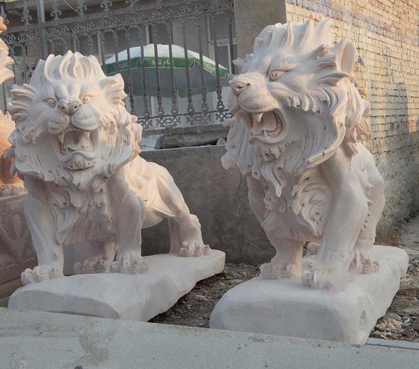 Large square stone lion sculpture
