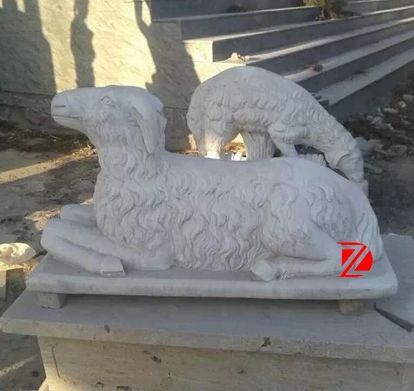 Garden sheep stone sculpture