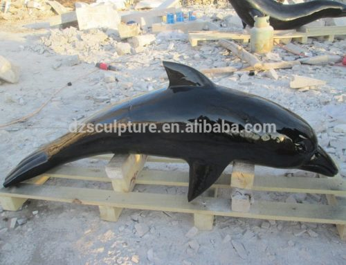 Black marble dolphin sculpture