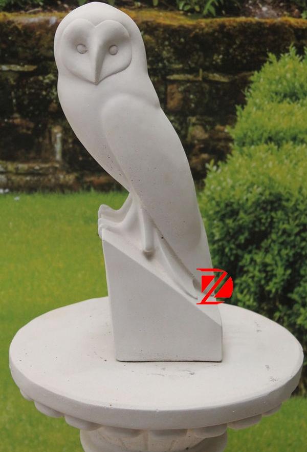 Garden bird stone sculpture