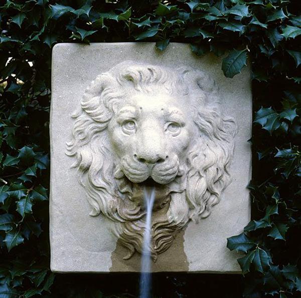 Lion wall fountain sculpture