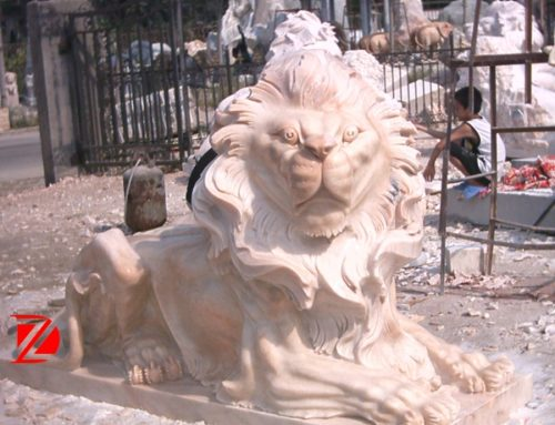 Yellow marble lion sculpture