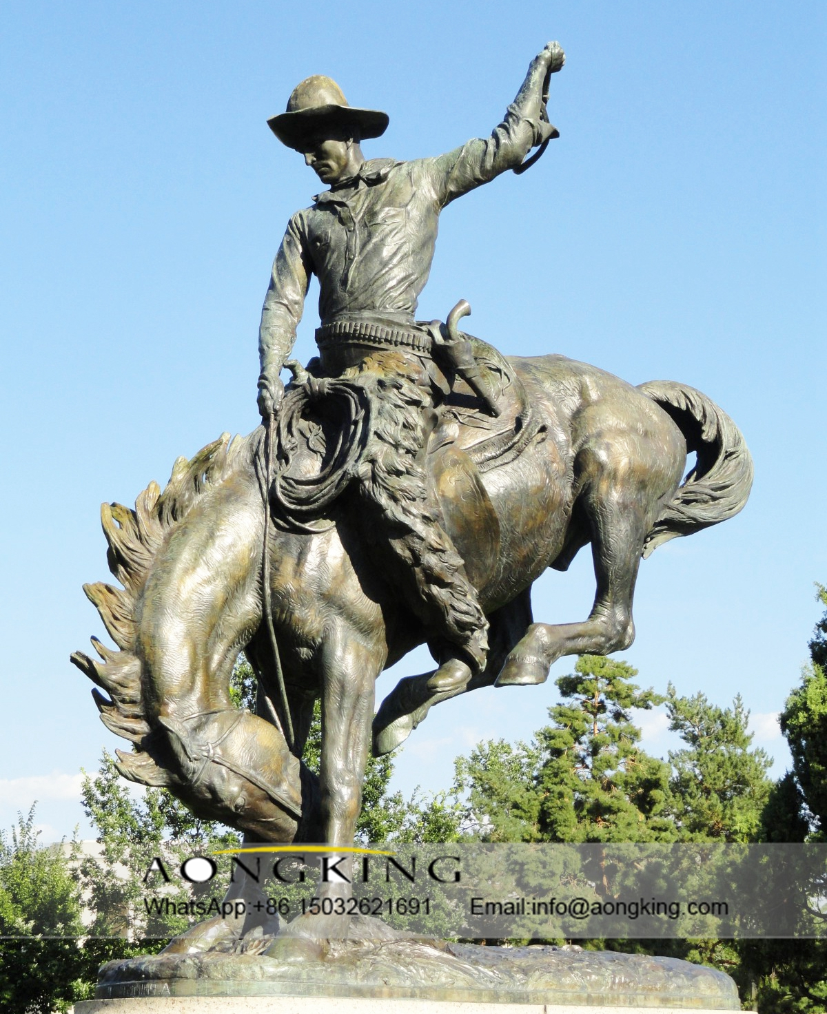 statue monument of cowboy horse