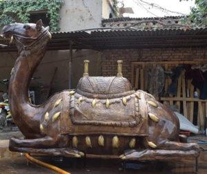 sitting camel sculpture