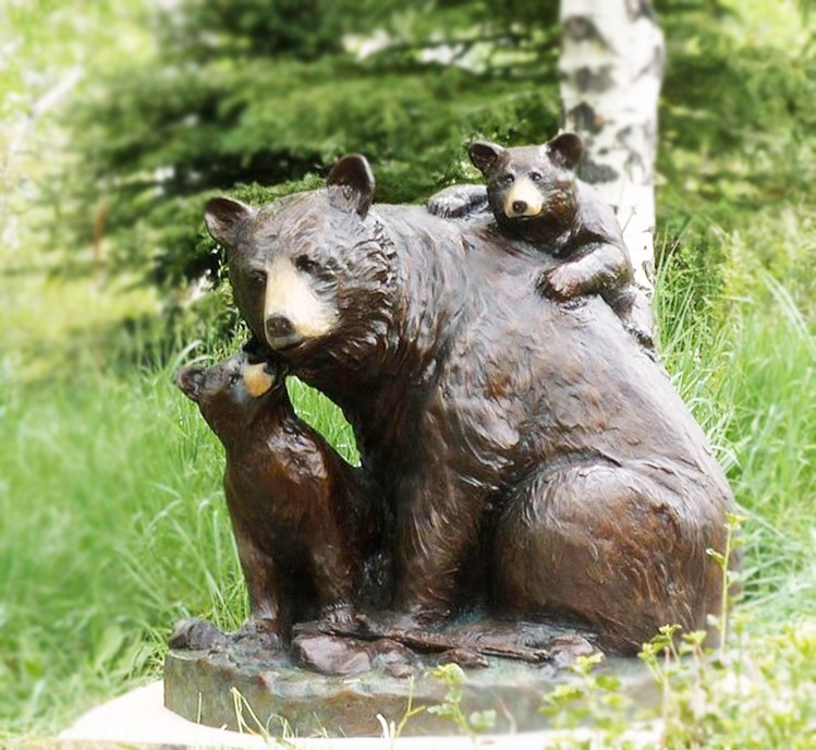 Animal statue of mother spectacled bear