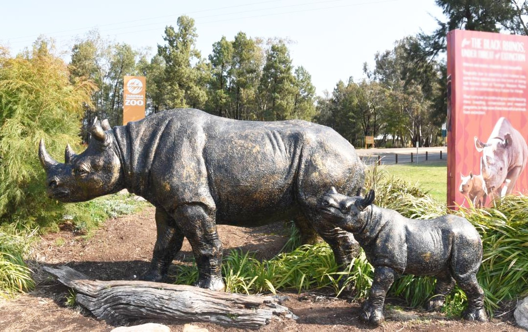 Bronze rhino sculpture with baby