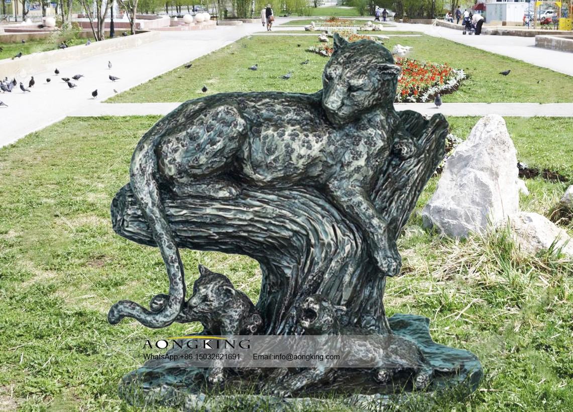 Laying down branch panthera pardus statue