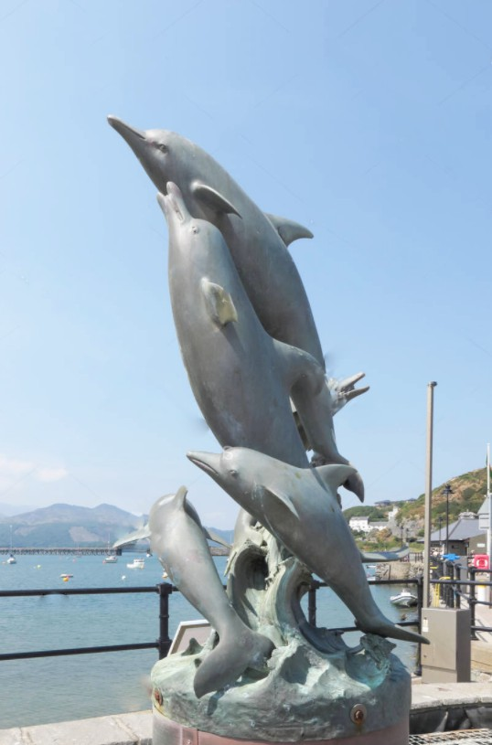 Leaping bottlenose dolphin sculpture
