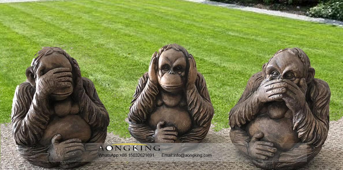 Three wise monkey statues