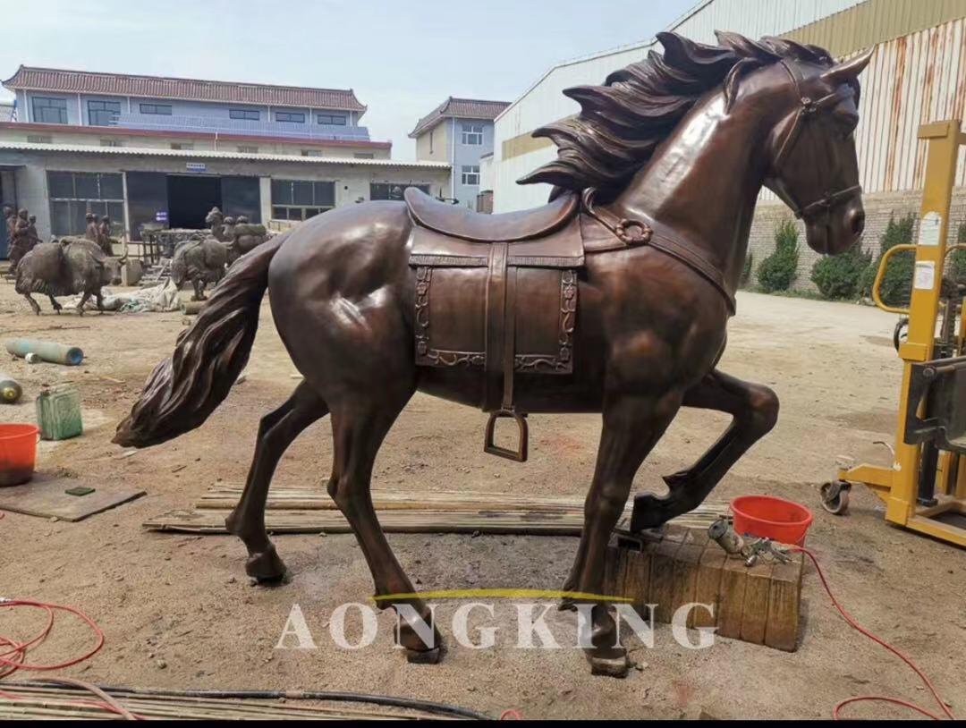 bronze horse statue with saddle