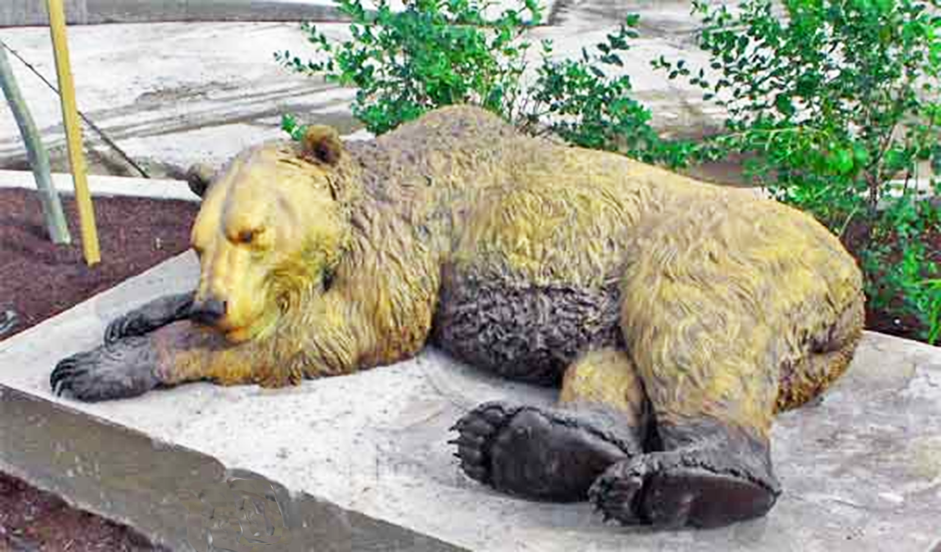 stretching bear statue