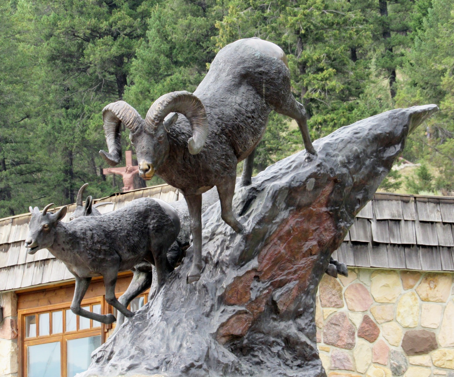 Bronze Animal standing on stone bighorn sheep sculpture