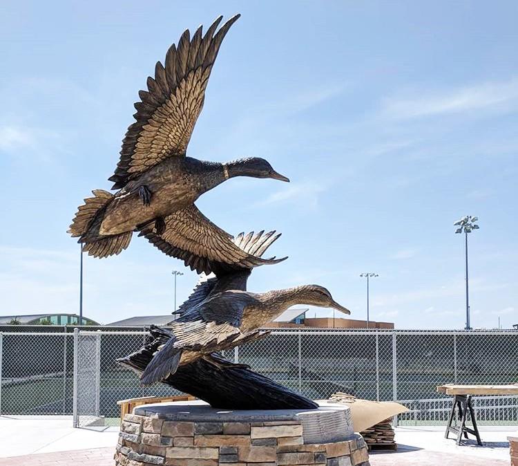 Bronze ducks sculpture