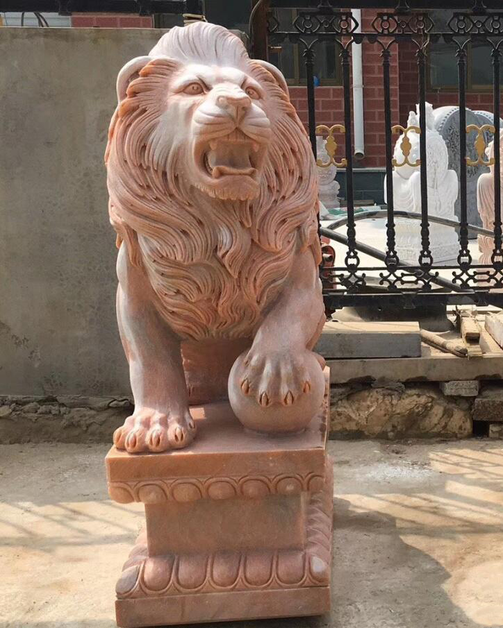 Carved stone lion sculptures