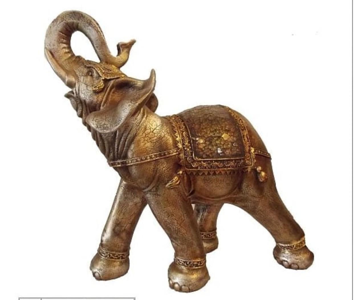 Gold color large elephant sculpture