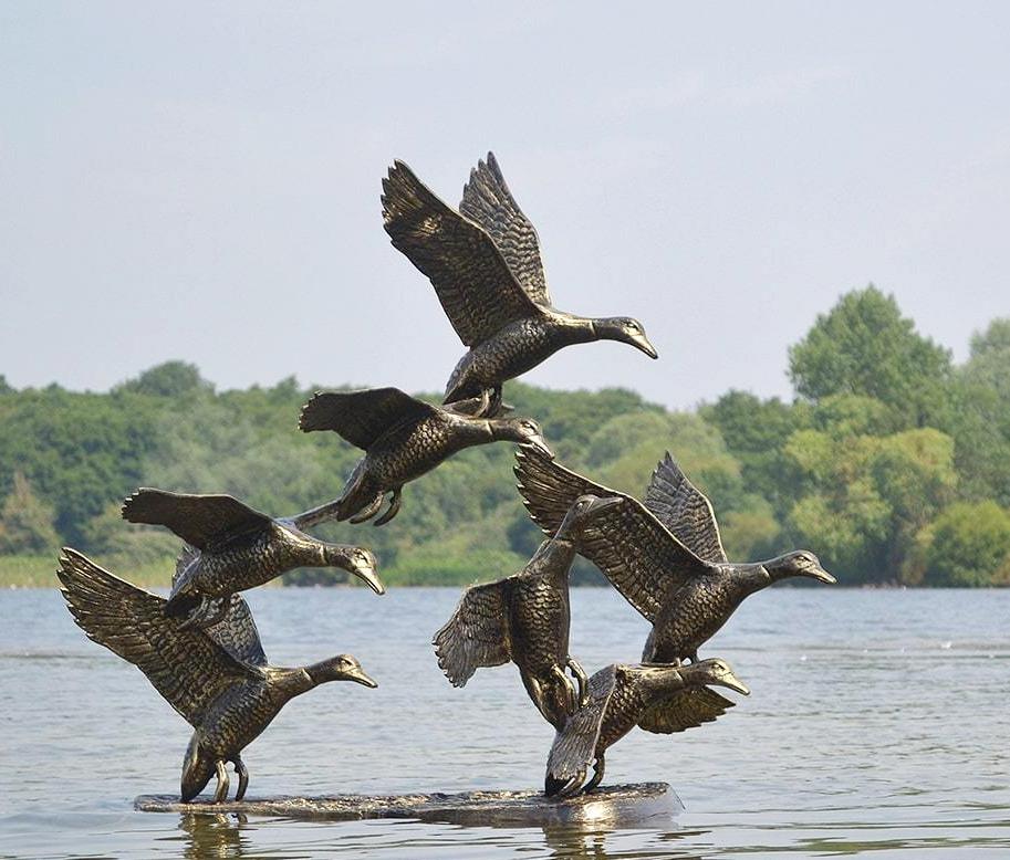 garden animal sculptures, swan sculpture