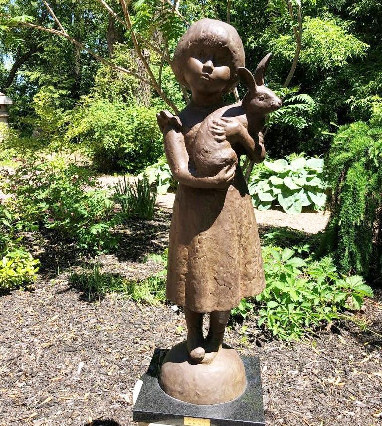bronze rabbit and girl sculpture