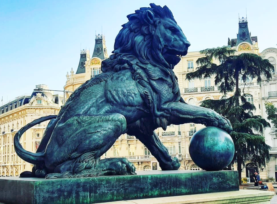 Lion with ball sculpture