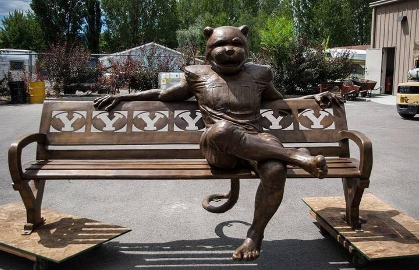 sitting cat man sculpture