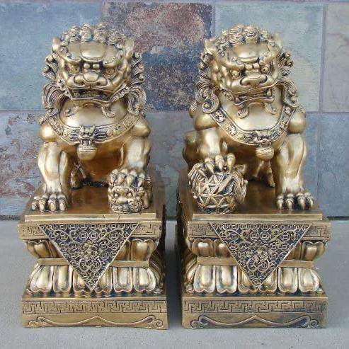 Golden bronze foo dogs