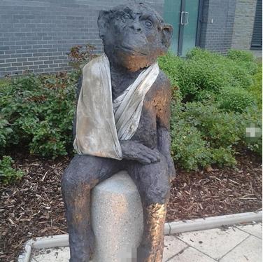 injured monkey sculpture